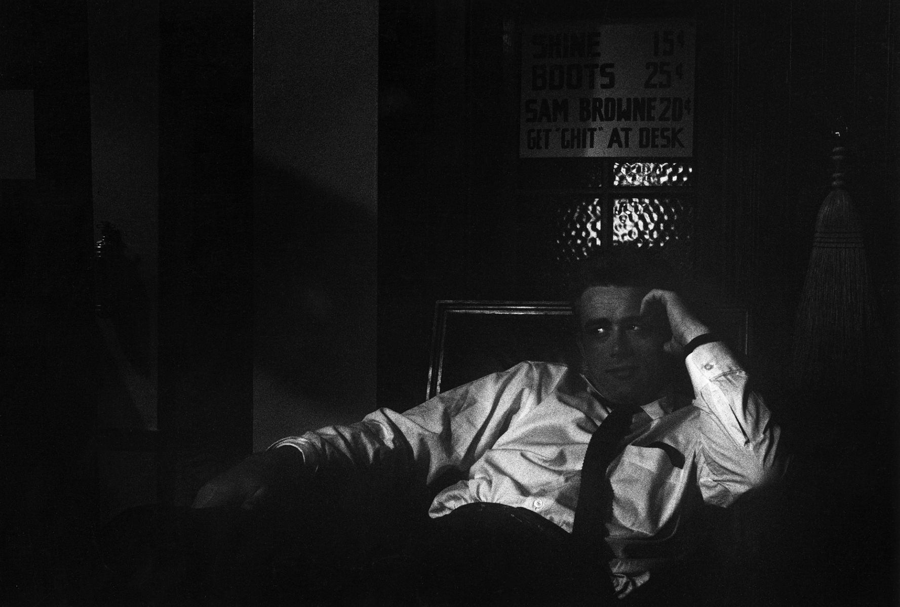 James Dean sitting in the shadows on the Warner Bros. set of Rebel Without a Cause, 1955.