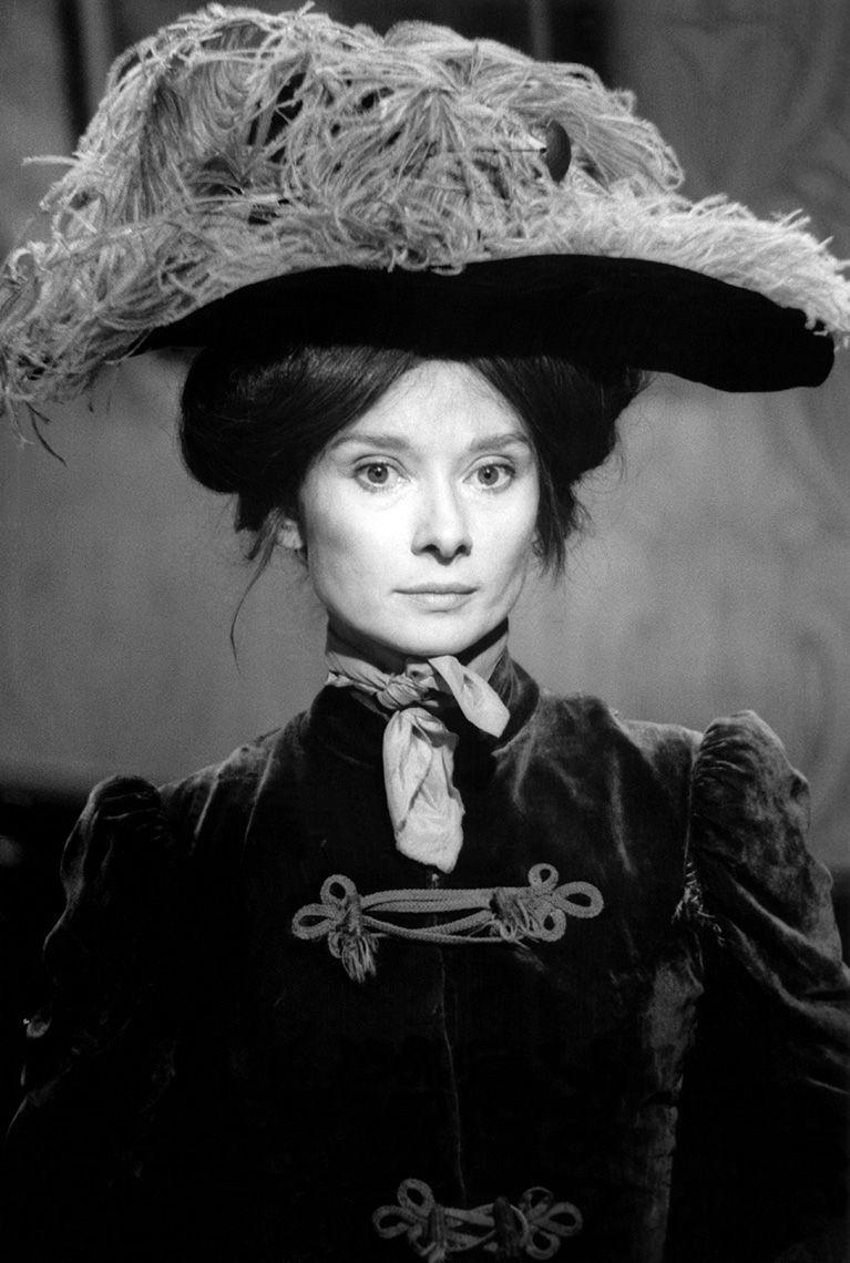 Audrey Hepburn portrait as Eliza on Warner Bros. set of My Fair Lady, 1963.
