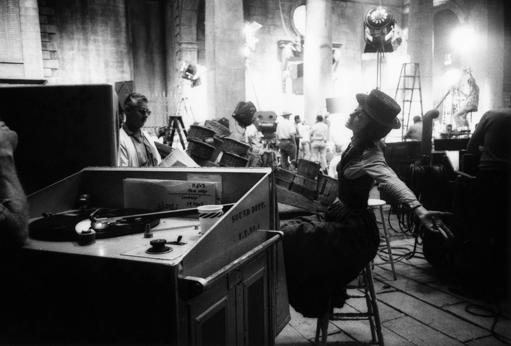 Audrey Hepburn rehearses the Loverly number with playback on the Warner Bros. set of My Fair Lady, 1963.