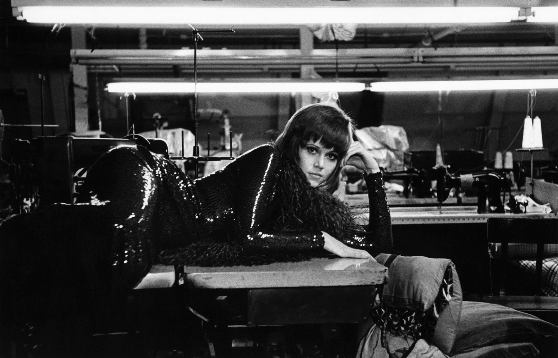 "Jane Fonda resting in a New York City garment factory during shooting of ""Klute,"" 1970."