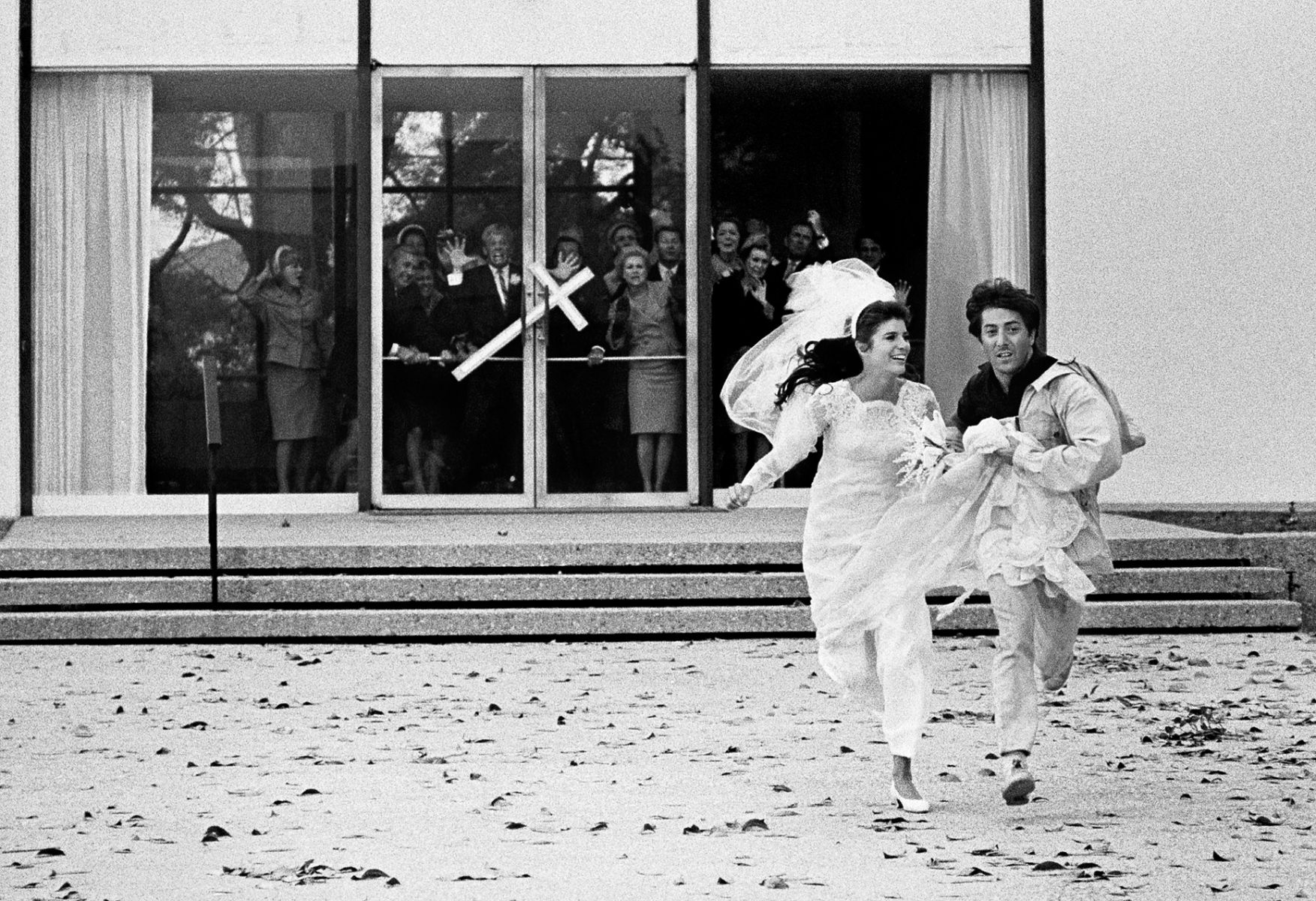Katharine Ross and Dustin Hoffman running away from the church at the end of The Graduate, Paramount Studios, 1967.