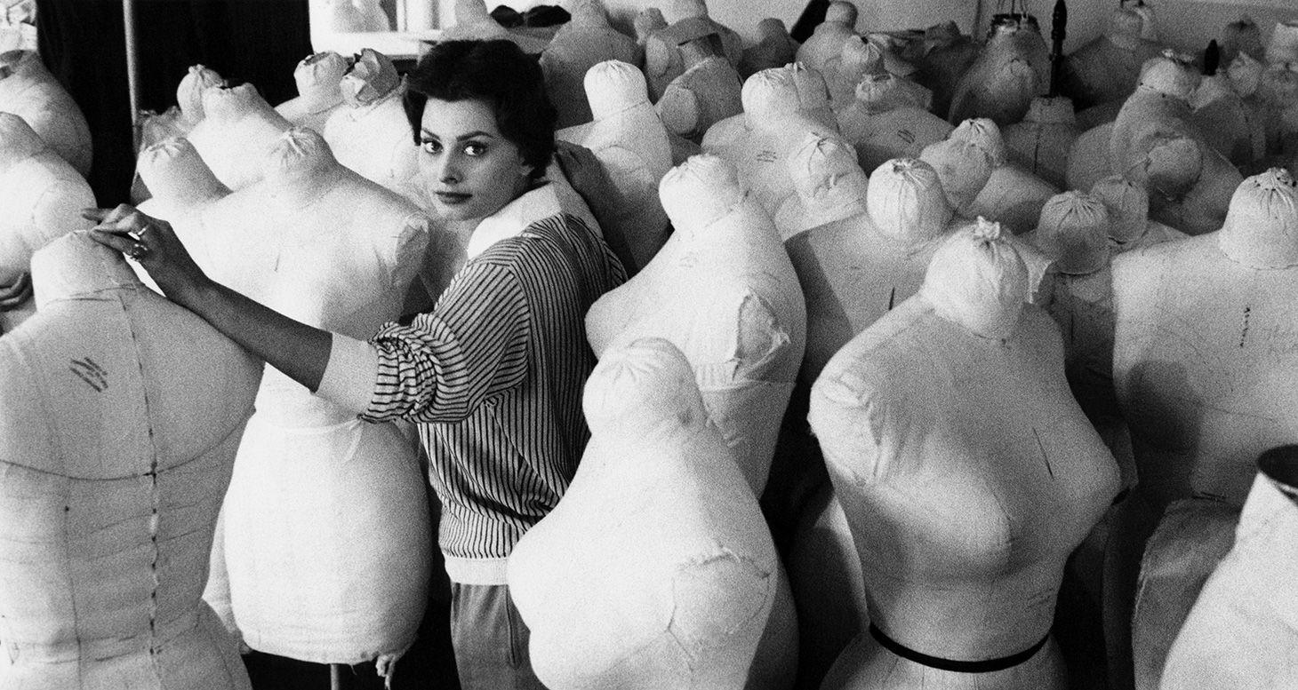 Sophia Loren surrounded by other actresses' dress forms in the Paramount Studios Wardrobe Department, 1958.