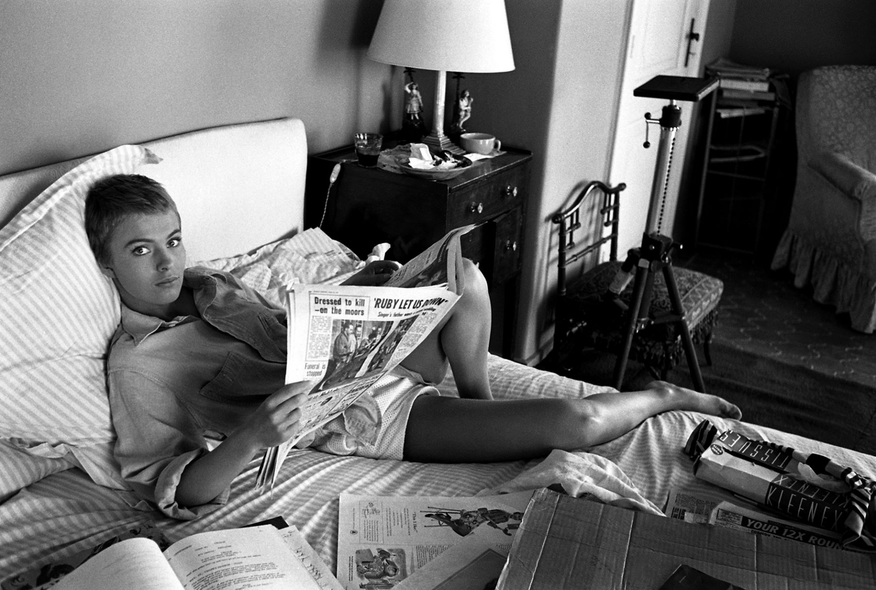 Jean Seberg reading paper in bed, during filming of Bonjour Tristesse in France, 1957.