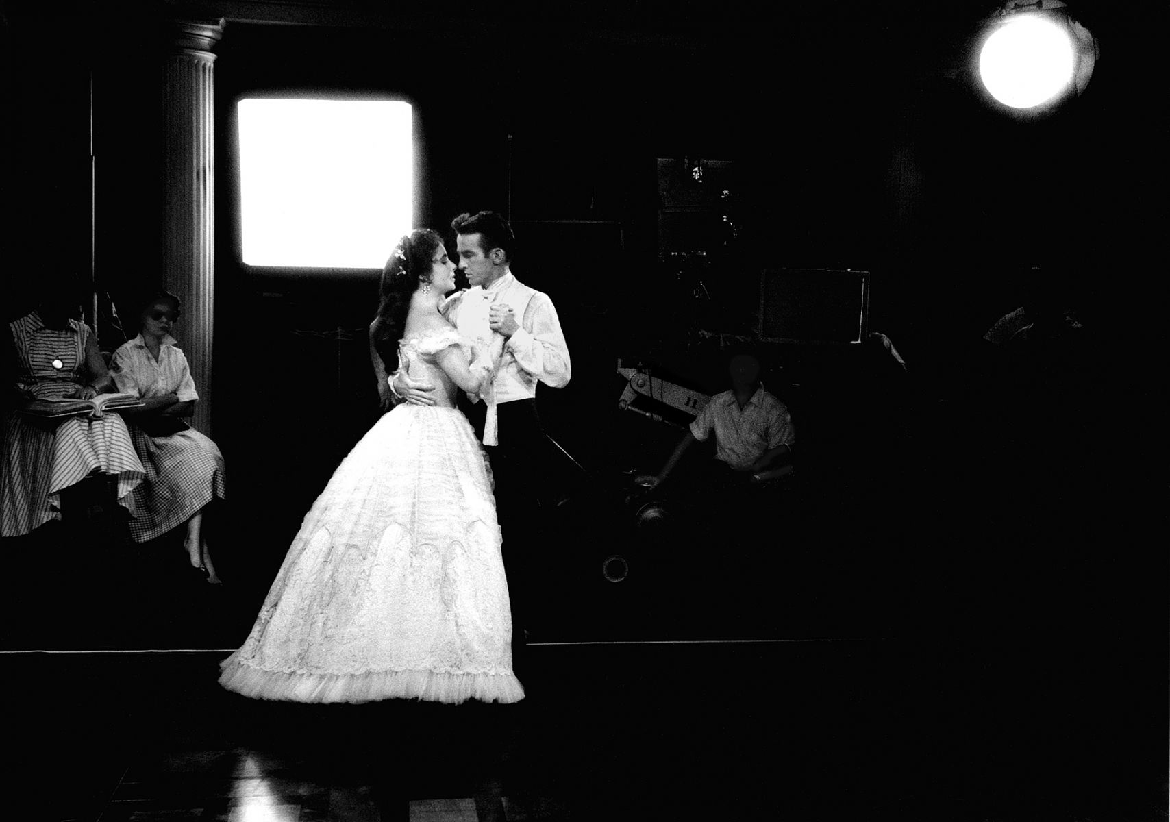 Elizabeth Taylor and Montgomery Clift dance in rehearsal on the MGM set of Raintree County, 1956.