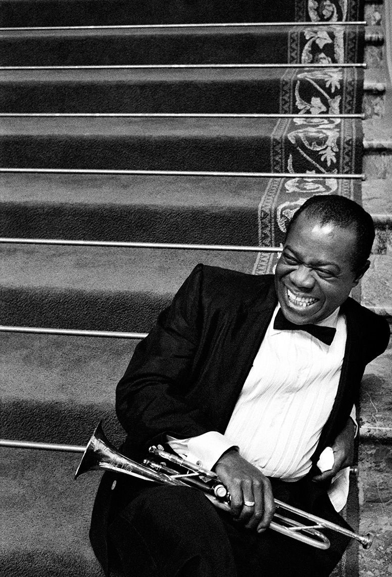 Louis Armstrong on the stairs at MGM between takes on High Society, 1956.