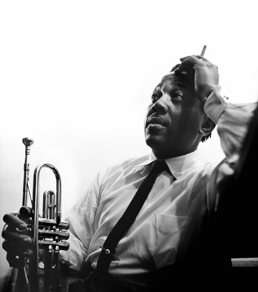 Roy Eldridge relaxes backstage at the Shrine Auditorium in Los Angeles, 1950.