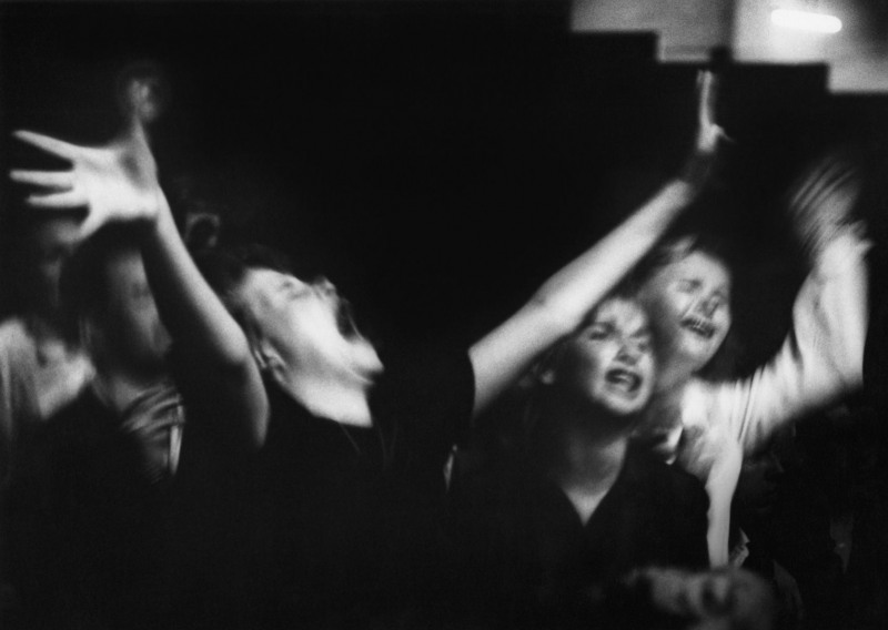 Young girls screaming with wild abandon at the Big Jay McNeely concert at Olympic Auditorium; Los Angeles, 1951.