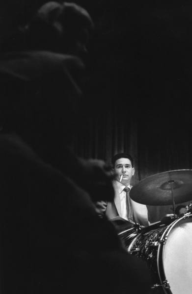 Shelly Manne (and June Christy in foreground) with the Stan Kenton Orchestra at Rendezvous Ballroom; Balboa, CA, 1950.
