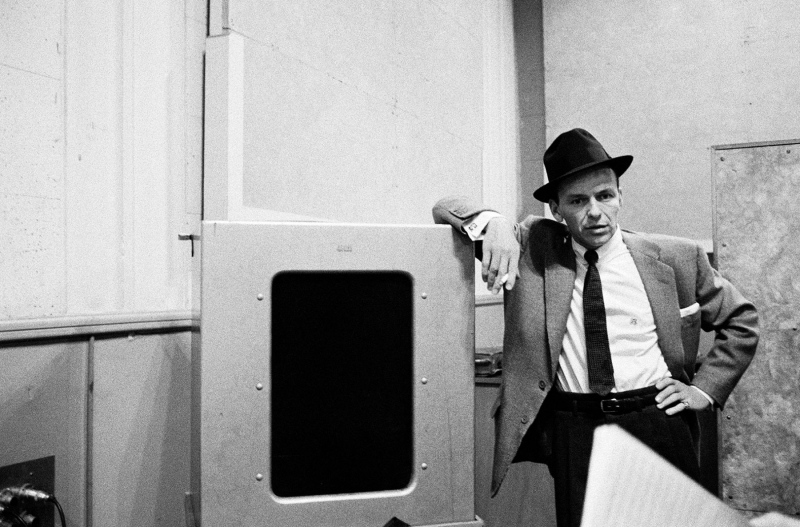 "Frank Sinatra listens to playback at ""The Man with the Golden Arm"" recording session, 1955."