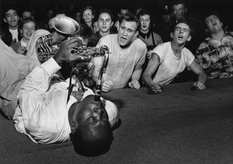 Big Jay McNeely driving the crowd into a frenzy at his concert at Olympic Auditorium; Los Angeles, 1951.