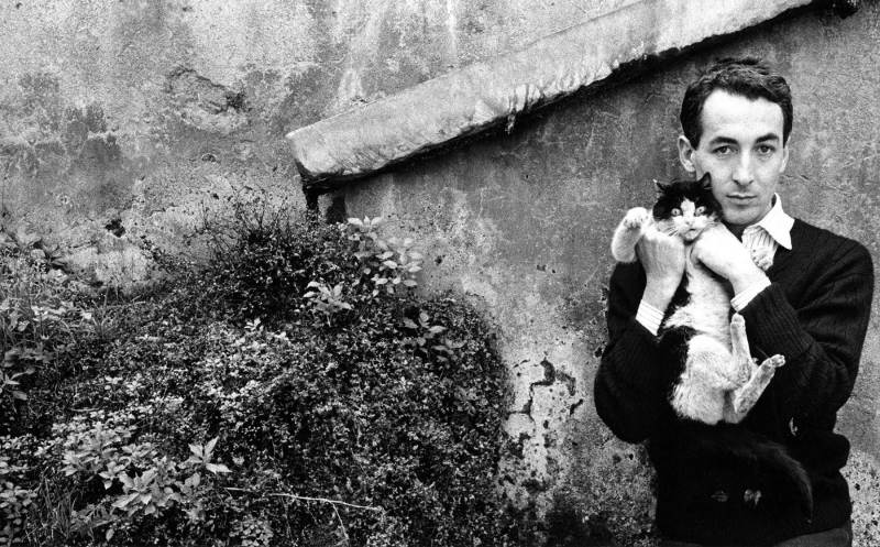 Enrico Colombotto Rosso with a wild cat; Rome, 1957.