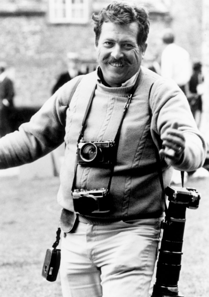 Photographer Bob Willoughby with cameras and a big smile
